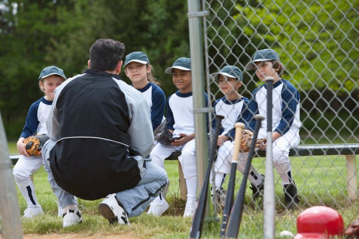 baseball-coach-with-kids
